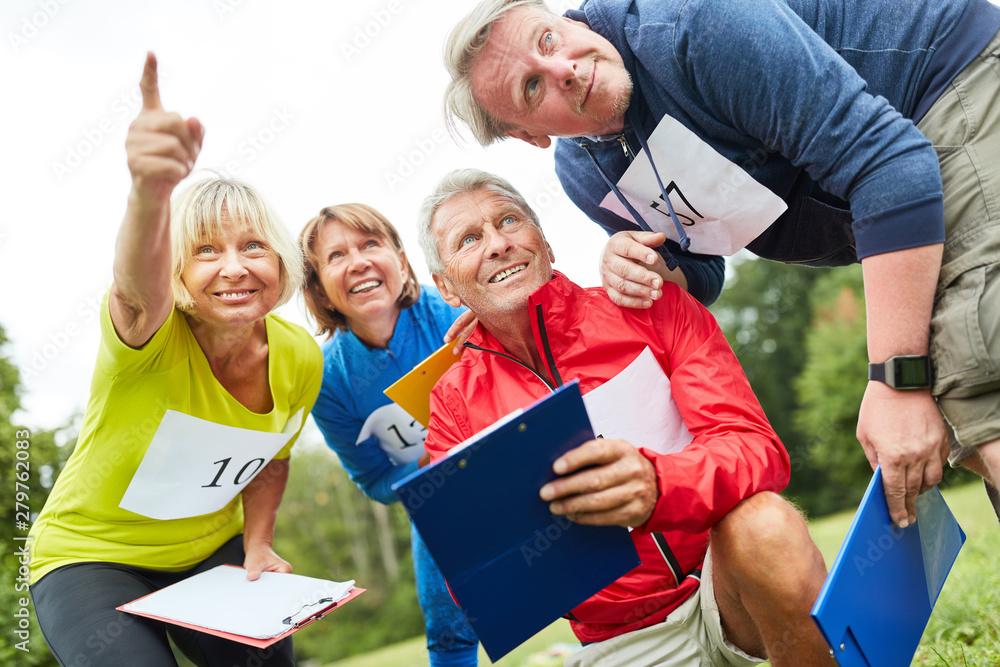 Fototapeta Seniors at a Geocaching Game