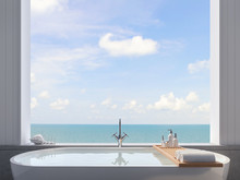 Close Up Of Bathtub With Sea View Background 3d Render,There Are White Wood Plank Wall, There Are Large Open Window Overlooking To Sea And Sky View.