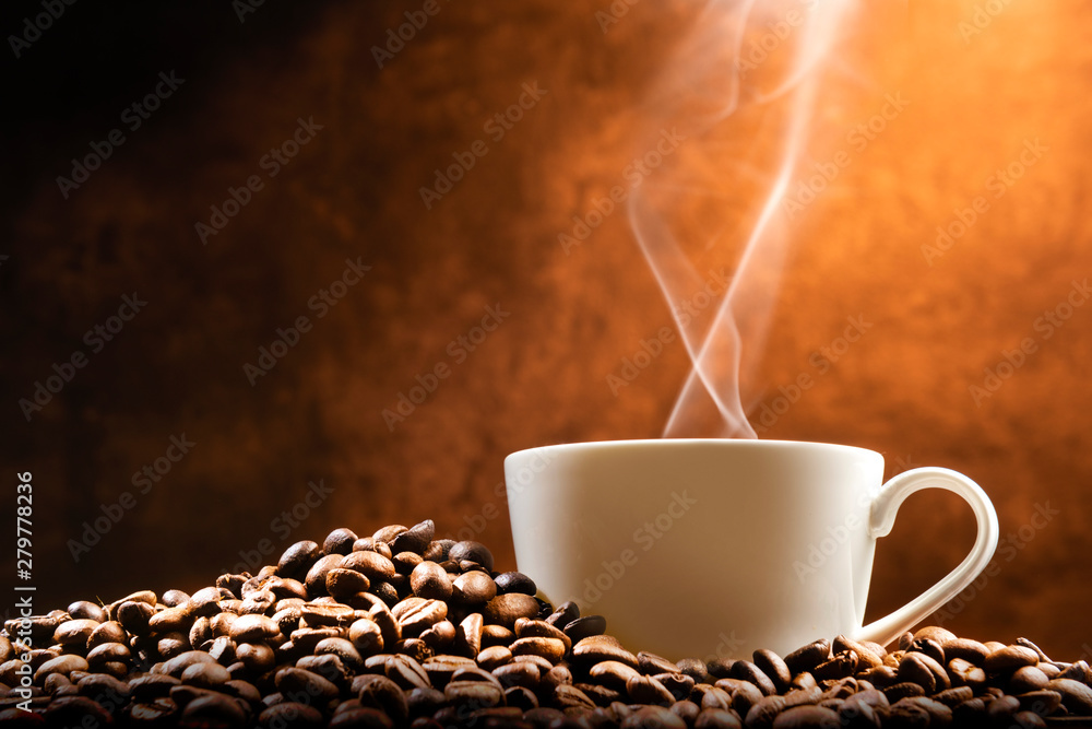 Fototapety, obrazy: Cup of hot coffee with coffee beans