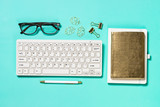 Fototapeta Kawa jest smaczna - Office workplace with keyboard, notepad, glasses and pen