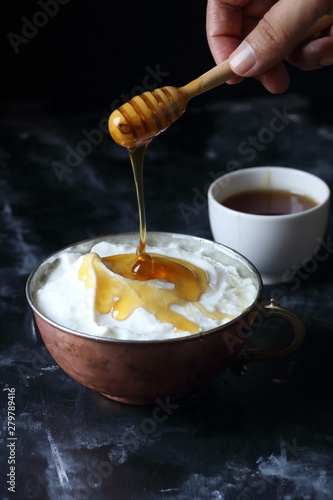 Honey and yogurt in a bowl,...