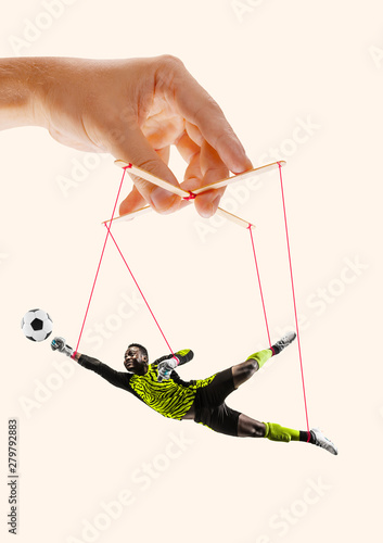 Photo  Man like a puppet in somebodies hands on yellow background