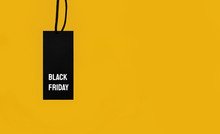 Sale Tag With Black Friday Inscription On Yellow Background.
