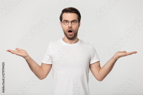 Recess Fitting Akt Shocked guy stretched open palms posing isolated on grey background