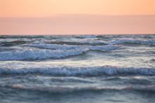 White Horses Sea Waves At Soft Orange Sunset