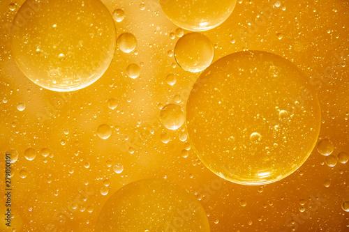 Fototapeta golden yellow bubble oil droplet, abstract background obraz