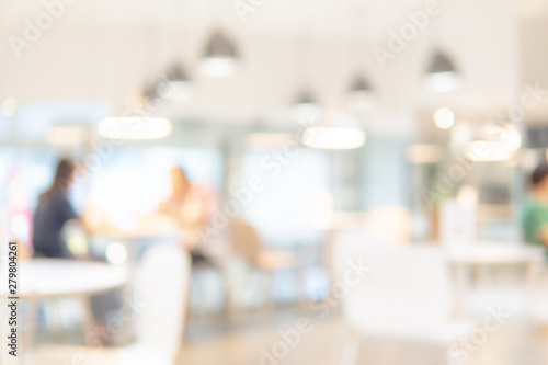 Fototapeta Abstract blurred restaurant background. Blurry cafe or coffee shop with dining tables, chairs and other decorations. Blur backdrop for design element. Food and beverage concept. obraz