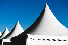 Pointed Tents Against The Blue...