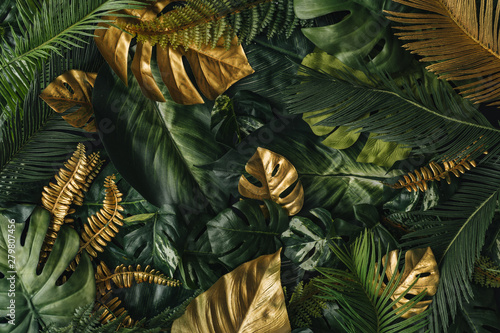 Obraz Creative nature background. Gold and green tropical palm leaves. Minimal summer abstract jungle or forest pattern. White paper frame copy space. - fototapety do salonu
