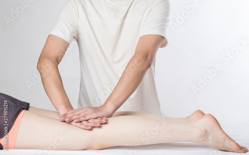Close-up of female hands doing foot massage - 279815214