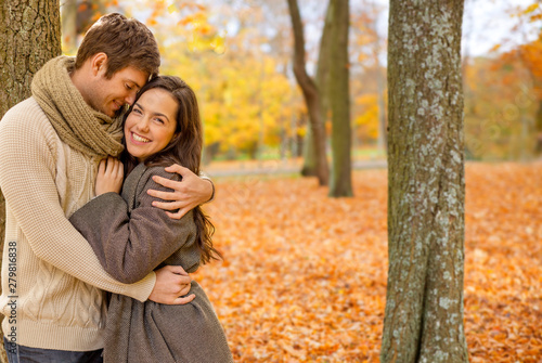 Fotografija love, relationship, family and people concept - smiling couple hugging in autumn