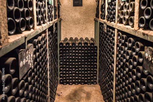 Obraz na plátně Vintage wine bottles in a cellar