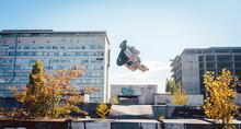 Acrobat Man Doing Somersault Mid Air On Urbex Session
