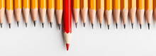 Red Pencil Protruding Out Of Row With Classic Ones