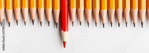 Obraz Red pencil protruding out of row with classic ones - fototapety do salonu
