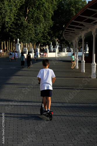 Fotografie, Obraz  Boy playing with a scooter