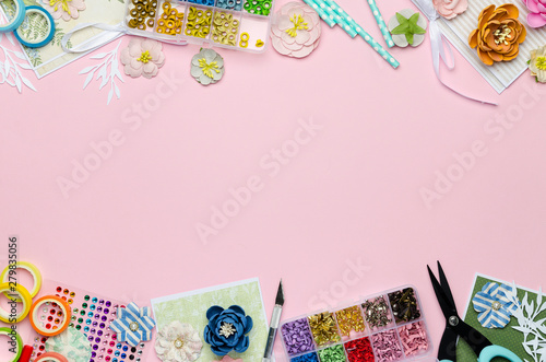 Fotografía Paper flowers, tools, paper and scrapbooking items on pink background