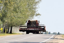 Modern Combine Harvester Moves By Road