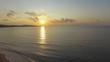 Sunset on beach. AERIAL: Landscape of sea coast at sunset. Sea bay near island at sunset, aerial video