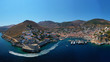 Aerial drone panoramic photo of picturesque port and main village of Hydra or Ydra island with beautiful neoclassic houses, Saronic gulf, Greece