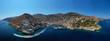 Leinwandbild Motiv Aerial drone panoramic photo of picturesque port and main village of Hydra or Ydra island with beautiful neoclassic houses, Saronic gulf, Greece