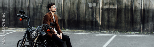Fototapety, obrazy: panoramic shot of man in brown jacket resting on motorcycle