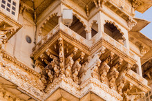 Carved Sandstone Exterior Walls Of The Udaipur Palace With Arches, Balcony And Windows