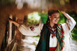 Leinwandbild Motiv Beautiful girl in a traditional Ukrainian dress smiles