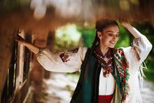 Beautiful Girl In A Traditional Ukrainian Dress Smiles