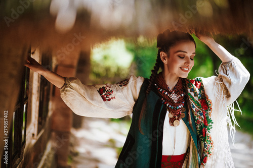 Photo  Beautiful girl in a traditional Ukrainian dress smiles