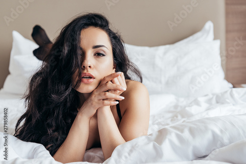 Fototapety, obrazy: front view of sexy undressed young woman lying in bed in bedroom