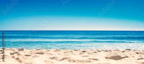 Stampa su Tela Blue ocean wave on sandy beach. Summer Vacation concept .