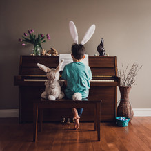 Boy Wearing Bunny Ears Playing...