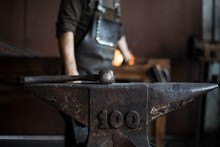 Hammer On Grungy Anvil In A Wo...
