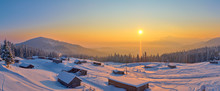 Morning Panorama Of The Winter Mountains Covered By The Fresh Snow With Old Barns On The Mountainsides.