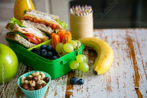 Back to school concept - packed school lunch on kitchen background, copy space - 279879637