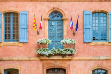 Colorful Ochre Colored Fa?ade Of Mairie (mayor's Office) In Roussillon, Vaucluse, Provence-Alpes-C?te D'Azur, France