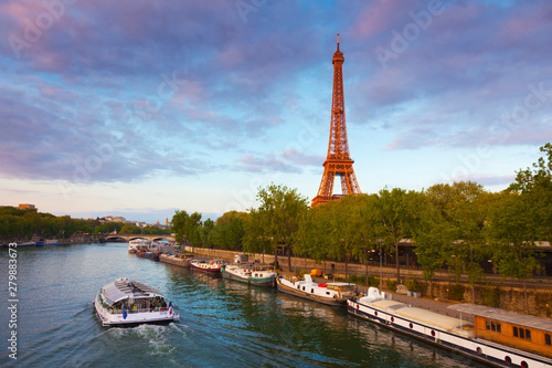 France, Paris, Eiffel Tower and tourist boat on River Seine - 279883673