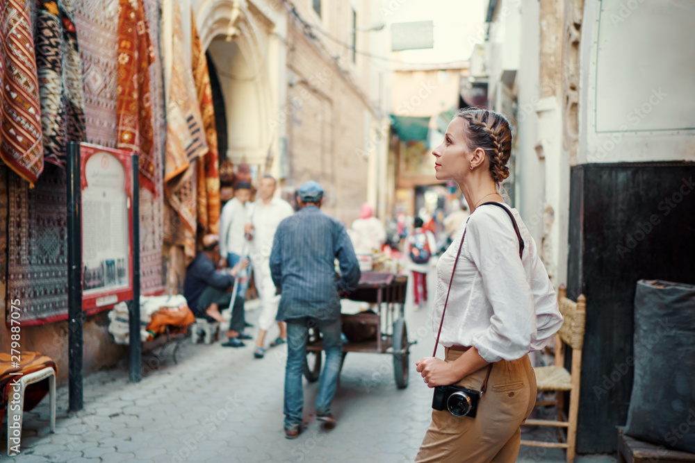 Fototapety, obrazy: Tourism and technology. Happy young woman taking photo of  Marrakesh old town. Traveling by Morocco.