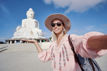 Traveling By Thailand. Pretty Young Woman In Hat Taking Selfie In The Big Buddha Temple, Famous Phuket Sightseeing.
