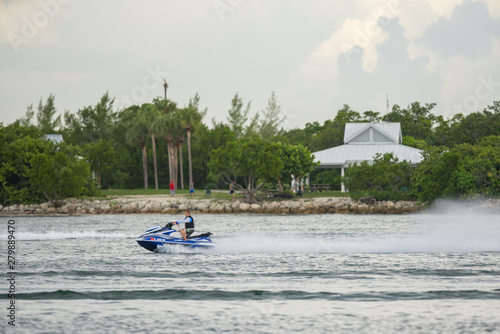 Spoed Foto op Canvas Zanzibar Young man racing a Yamaha wave runner in Miami. Shot with a telephoto lens
