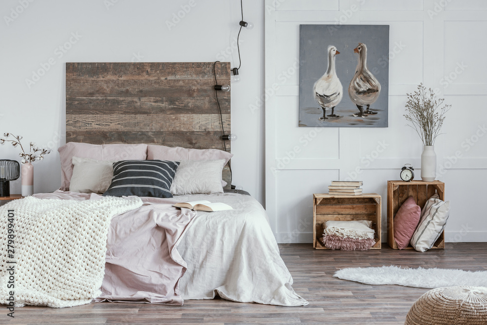 Fototapety, obrazy: Spacious, feminine bedroom interior with rustic furniture, white walls, wooden crates and oil painting of animals. Real photo