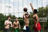 selective focus of shirtless sportsmen playing basketball at basketball court