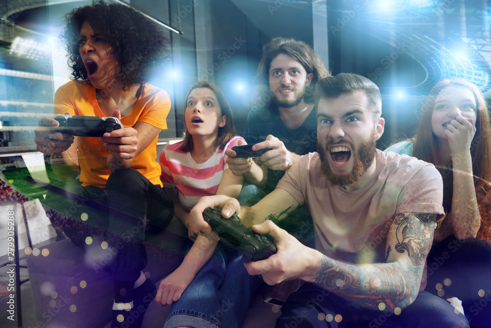Fototapety, obrazy: Group of friends play at soccer game