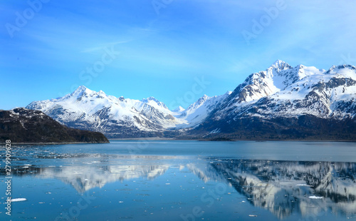 Glacier Bay in Alaska with reflection in the water.