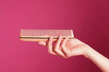 Woman Holding Wooden Hair Comb...