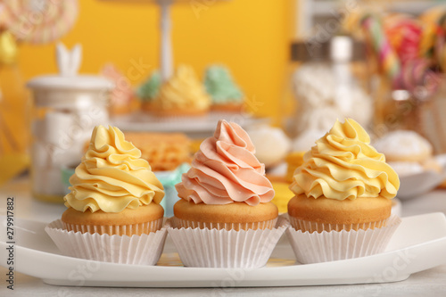 Tasty cupcakes and other sweets on table. Candy bar, closeup view Canvas Print