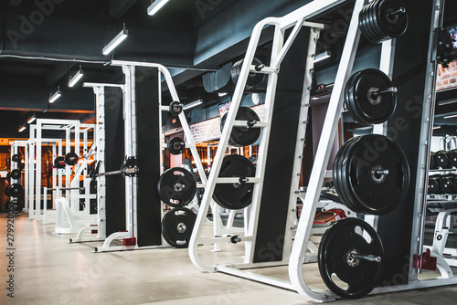 Photo Modern light gym. Sports equipment in gym