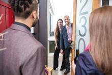 Couple Arriving At Housewarming Party