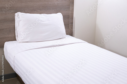 White single bed and pillow in the bed room close up. - Buy ...